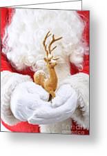 Santa Holding Reindeer Figure Greeting Card