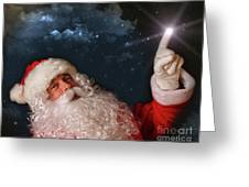 Santa Pointing With Magical Light To The Sky Greeting Card by Sandra Cunningham