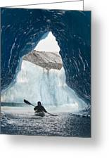 Sea Kayaker Paddles Through An Ice Cave Greeting Card