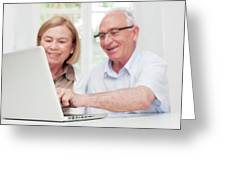 Senior Couple Using Laptop Greeting Card
