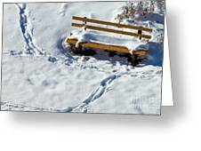 Snowy Foot Prints Around Snow Covered Park Bench Greeting Card