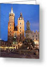 St Mary Basilica And Adam Mickiewicz Monument At Night In Krakow Greeting Card