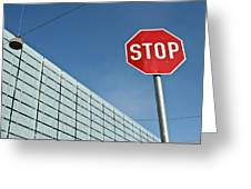 Stop Sign And Building In The Background Greeting Card