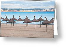 Straw Umbrellas On Empty Beach Greeting Card