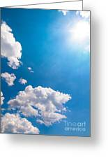 Sun Burst On A Blue Sky And Clouds Greeting Card