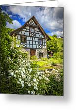 Swiss Chalet In The Garden Greeting Card by Debra and Dave Vanderlaan