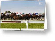 The Blur Of Racehorses Racing By The Rails On A Race Track  Greeting Card