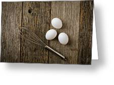 Three Eggs And Whisk Or Egg Beater On Rustic Wood Background Greeting Card