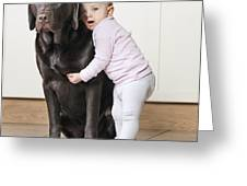 Toddler With Dog Greeting Card by Justin Paget
