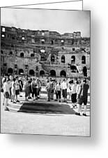 Tour Guide Explains To Group Of British Tourists About Gladiator Pits On The Floor Of The Arena Of The Old Roman Colloseum At El Jem Tunisia Vertical Greeting Card
