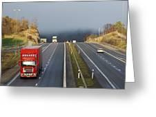 Trucks Driving Through A Misty Mountain Pass Greeting Card