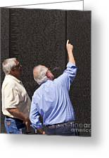 Veterans Look For A Fallen Soldier's Name On The Vietnam War Memorial Wall Greeting Card