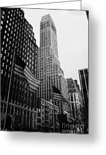 view of pennsylvania bldg nelson tower and US flags flying on 34th street from 1 penn plaza new york Greeting Card