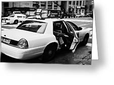 white caucasian passenger closes rear door of yellow cab on taxi rank at crosswalk on 7th Avenue Greeting Card