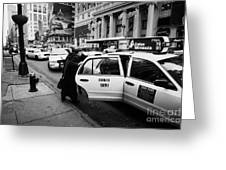 white middle aged passengers exit from yellow cab rear door at taxi rank on 7th Avenue Greeting Card