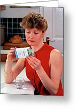 Woman Reading Dose Label On Pack Of Prozac Pills Greeting Card