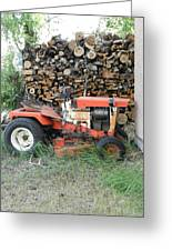 Wood Pile And Lawn Tractor Greeting Card