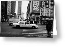 yellow cab taxi blurs past pedestrian waiting at crosswalk on Broadway outside macys new york usa Greeting Card