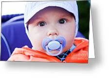 Young Baby Boy With A Dummy In His Mouth Outdoors Greeting Card
