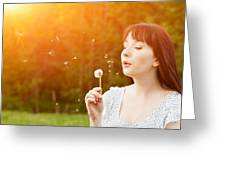 Young Beautiful Woman Blowing A Dandelion In Spring Scenery Greeting Card