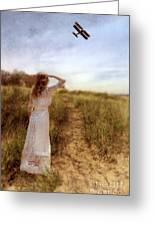 Young Lady In Vintage Clothing Watching A Biplane Greeting Card