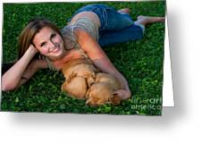 Young Woman And Golden Retriever Puppies Greeting Card