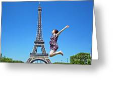 Young Woman Jumping Against Eiffel Tower Greeting Card