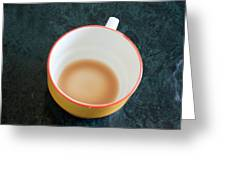 A Cup With The Remains Of Tea On A Green Table Greeting Card