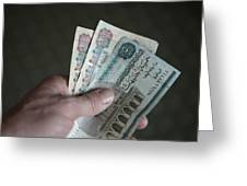 A Hand Holds Egyptian Pounds In Cash Greeting Card