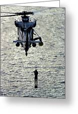 A Search And Rescue Swimmer Is Hoisted Greeting Card