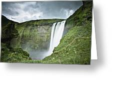 A Waterfall Over A Grassy Cliff Greeting Card