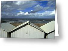 Beach Huts Under A Stormy Sky In Normandy Greeting Card