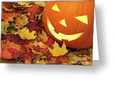 Carved Pumpkin On Fallen Leaves Greeting Card