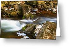 Flowing River Blurred Through Rocks Greeting Card