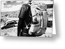 hiker hillwalker leaving busy side road with lots of cars parked in the highlands of Scotland UK Greeting Card