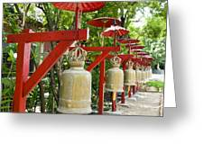 Row Of Bells In A Temple Covered By Red Umbrella Greeting Card