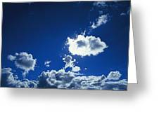 Sunlit Fluffy White Clouds In A Blue Greeting Card