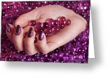 Woman Hand With Purple Nail Polish On Candy Greeting Card