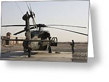 A Uh-60 Black Hawk Helicopter Parked Greeting Card
