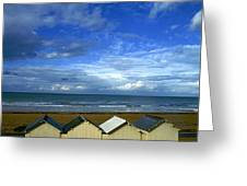 Beach Huts Under A Stormy Sky In Normandy Greeting Card by Bernard Jaubert