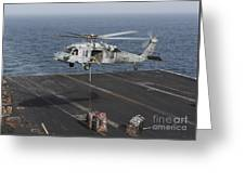 A Mh-60s Knighthawk Conducts A Vertical Greeting Card