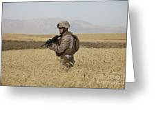 U.s. Marine Patrols A Wadi Near Kunduz Greeting Card