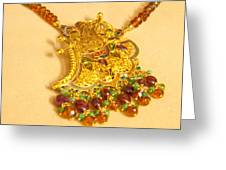 A Beautiful Intricately Carved Gold Pendant Hanging From A Semi-precious Stone Chain Greeting Card
