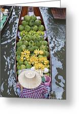 A Boat Laden With Fruit At The Damnoen Saduak Floating Market In Thailand Greeting Card