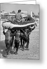 A Buds 1st Phase Boat Crew Carry An Greeting Card