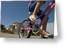 A Child Rides Her Bike Along The Beach Greeting Card