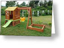 A Childs Playing Equipment In A Green Location Greeting Card