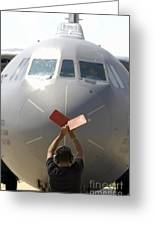 A Crew Chief Marshals In A C-141b Greeting Card