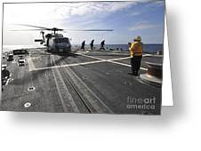 A Helicpter Sits On The Flight Deck Greeting Card