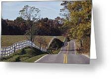 A Hilly Country Road Passes A Fenced Greeting Card